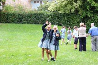Middle School girls waving
