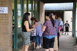 Miss Powys welcoming her new Kindergarten parents