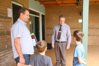 Mr Clayton, Principal meeting parents and students