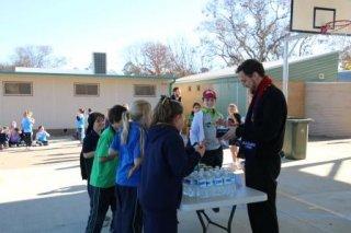 Defibrillator Fundraiser - Selling water to Mr J, School Caplain
